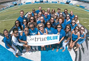MSTU Students with True Blue sign
